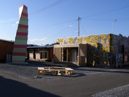 Photo of Temporary Housing Facility with Tower and Murals in Minami Souma City