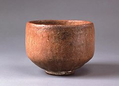 Photo of Red Raku tea bowl named Muichibutsu