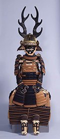 Photo of Suit of Armor with Dark Blue and Red Lacing